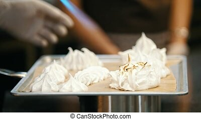 Process cooking of meringue - chef use fire for decorates...
