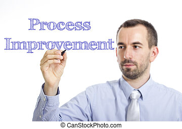 Process Improvement - Young businessman writing blue text on transparent surface
