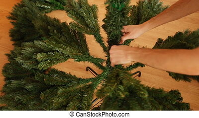 Process of assembling artificial christmas tree