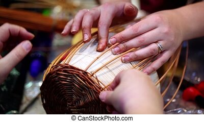 Process of basket braiding lesson, only hands visible