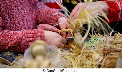 Process of bast braiding lesson, only hands visible