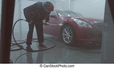 Process of cleaning auto at car wash