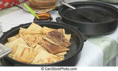 Process of cooking russian pancakes on a skillet - Process...