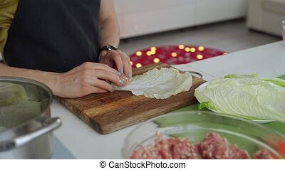 Process of cooking stuffed cabbage rolls with meat and rice.