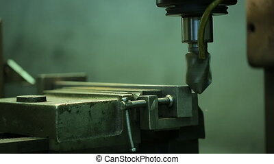 Process of grinding metal parts end mill on a horizontal machine.