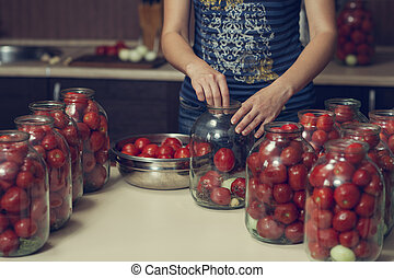 canning ripe tomatoes in the cans