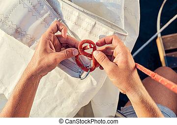 Process of knitting Bowline - User knitting knots. Bowline ...