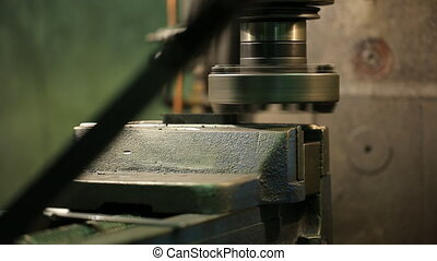 Process of machining metal parts on a vertical milling machine.