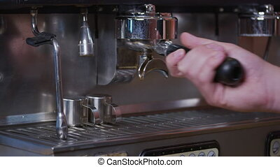 Process of making espresso in a coffee machine. Barista making latte in specialty coffee shop