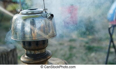 Process of making tea in the samovar. - the process of...