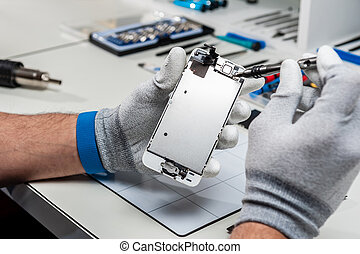 Process of mobile phone repair - Close-up photos showing...
