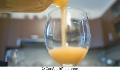Process of pouring homemade apple juice with pulp - The ...