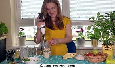 process of preparing green fruit cocktail. Pregnant woman...