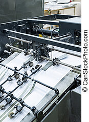 Process of printing at factory: close-up of linotype machine using technology for typesetting text