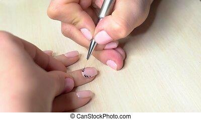 Process of receiving manicure in beauty salon. Manicurist...