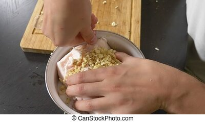 process of salting pork fat. lard in an enameled bowl with garlic and pepper, covered with salt