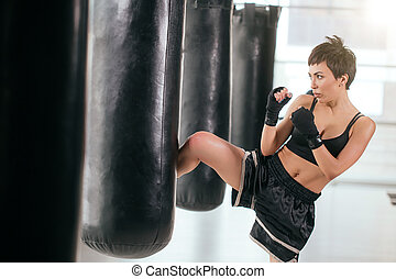 process of woman's individual boxing training. be fond of kickboxing.