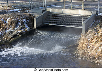 Processed and cleaned sewage flowing out of water ...