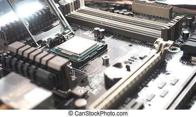 Processor installation in motherboard - Macro of hand...