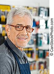 prodavač, usmívaní, do, materiální stránka technologie nadbytek