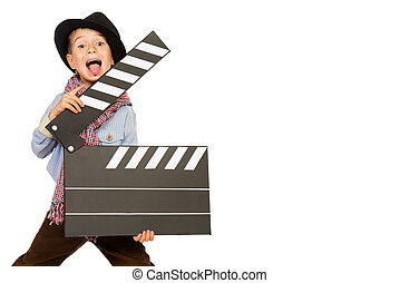 producer - Cheerful boy holding clapper board. Different...
