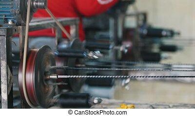 Producing of fiberglass reinforcement - machine is spinning...