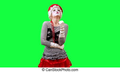 Girl mime points to something. This clip is pre-matted with an embedded alpha-channel. It can be composited over any background.