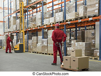 product stacking - workers in uniforms and safety helmets ...