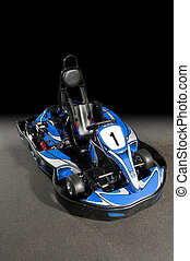 Product type of photo of a Go-Kart on the track, fading into a black background