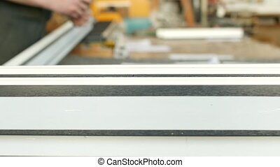 Production and manufacturing of pvc windows, male worker is...
