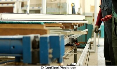 Production and manufacturing of pvc windows, male worker ...