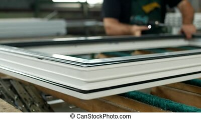 Production and manufacturing of pvc windows, the male worker...