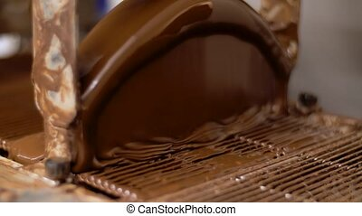working chocolate coating machine at confectionery -...