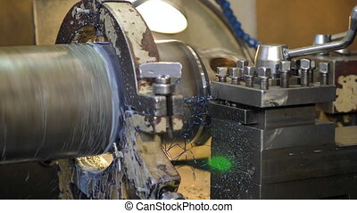 Production lathe removes metal chips - Metal shaving on...