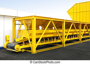 Production line - Big yellow industry plant with conveyer...