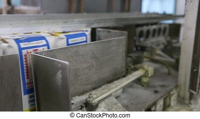 Production line for packaging. - Filling empty boxes with...