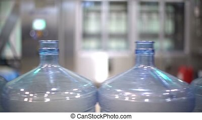 Production line. Water bottle conveyor industry. Plastic bottles