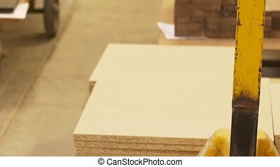 chipboards on loader at furniture factory storage -...