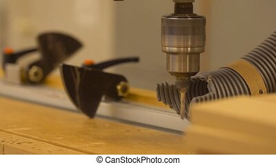 drill press machine and wooden board at workshop -...