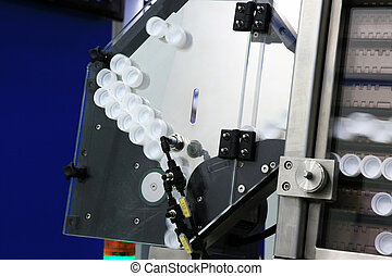 production of bottled water - Automatic bottle cap feeding...