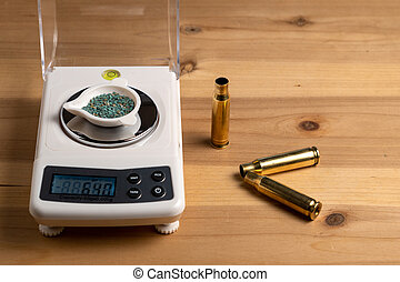Production of cartridges for a rifle, reload. Empty shells and gunpowder scales