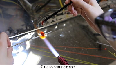 Production of hand made beads in workshop, seventh video