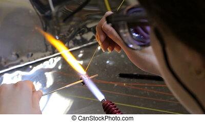 Production of hand made beads, twenty-third video -...