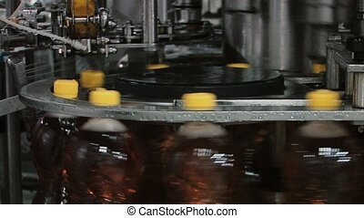 Production of plastic bottles with juice on the factory conveyor