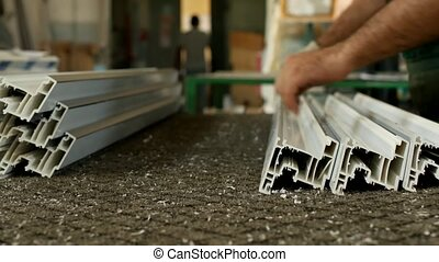 Production of pvc windows, male worker punctures the details...