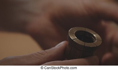 Production of rings. Jeweler working with wax model ring in...