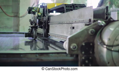 Production of window glass with a machine on the window factory. 4K