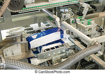 production of women's sanitary napkins - factory and...
