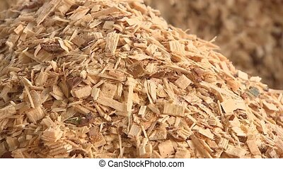 Production of wood shavings at a woodworking factory. ...