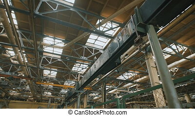 Production premise with a high ceiling. Many metal...